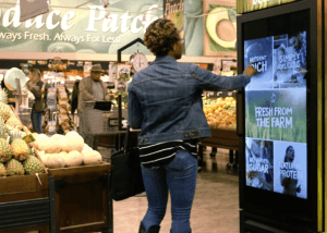 Woman using the Magic Mirror in a supermarket